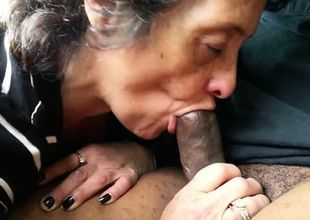 Grandma munching at a meatstick that..