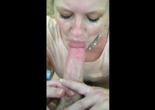 Sexy blondie mummy munching a spear