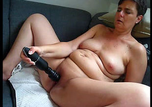 Sex-starved mature thrusts wand as..